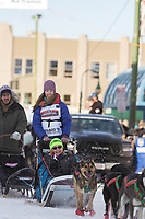 Shaynee Traska and team leave the ceremonial start line with an Iditarider at 4th Avenue and D street in downtown Anchorage, Alaska on Saturday March 2nd during the 2019 Iditarod race. Photo by Brendan Smith/SchultzPhoto.com