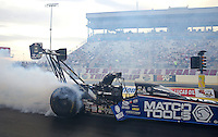 Apr. 5, 2013; Las Vegas, NV, USA: NHRA top fuel dragster driver Antron Brown during qualifying for the Summitracing.com Nationals at the Strip at Las Vegas Motor Speedway. Mandatory Credit: Mark J. Rebilas-