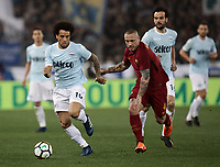 Calcio, Serie A: S.S. Lazio - A.S. Roma, stadio Olimpico, Roma, 15 aprile 2018. <br /> Lazio's Felipe Anderson (l) in action with Radja Nainggolan (r) during the Italian Serie A football match between S.S. Lazio and A.S. Roma at Rome's Olympic stadium, Rome on April 15, 2018.<br /> UPDATE IMAGES PRESS/Isabella Bonotto