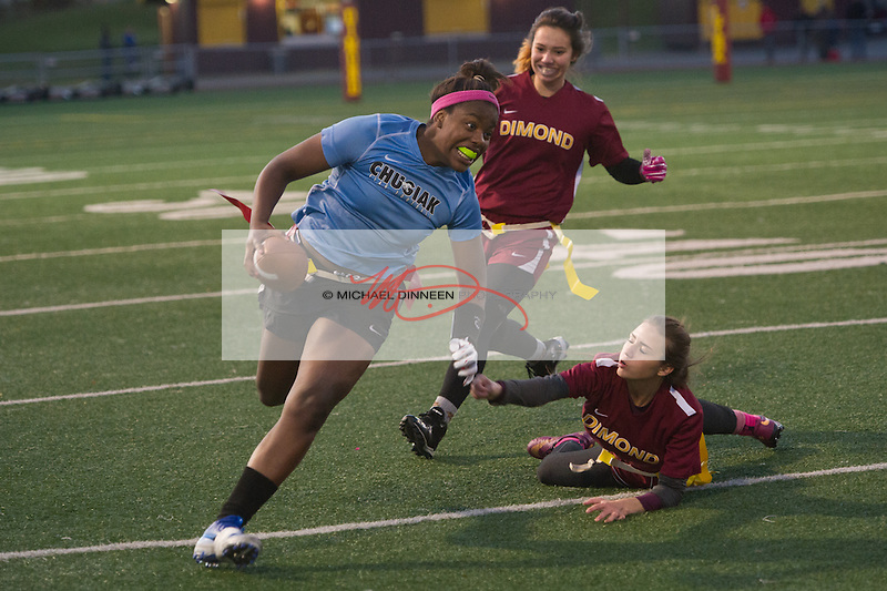 Chastity Shelden avoids a pair of Dimond defenders in their CIC Flag Football playoff game Thursday, Oct 13, 2016.  Photo for the Star by Michael Dinneen