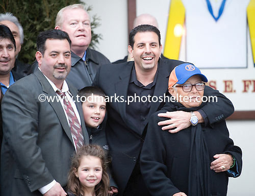 """Mike Repoli, owner of Stay Thirsty, hugs his """"nona"""" (grandmother) in the Aqueduct winner's circe after the Gotham Stakes, April 6, 2011."""