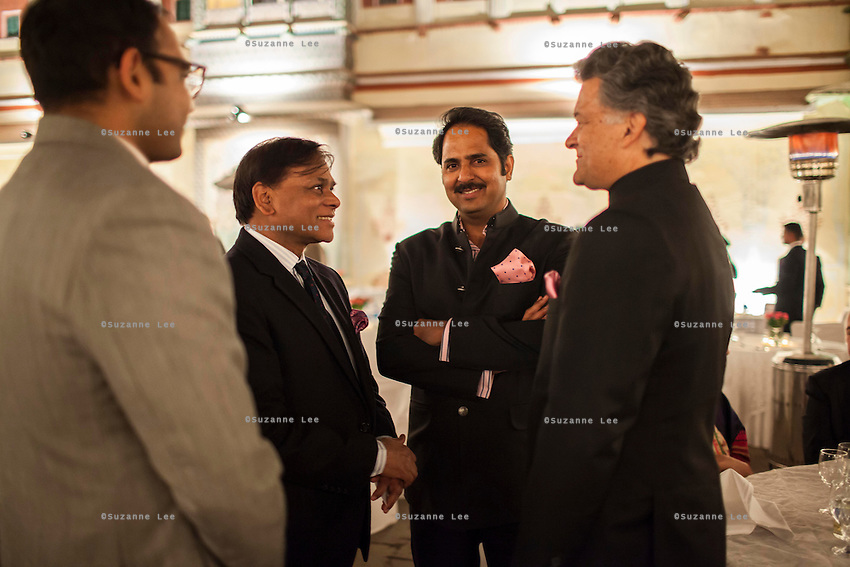 Nik Senapati (right), Managing Director of Argyle Diamonds and Maharaj Narendra Singh of Jaipur (2nd from right) share a conversation with other guests at the OzFest Gala Dinner in the Jaipur City Palace, in Rajasthan, India on 10 January 2013. Photo by Suzanne Lee