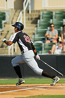 Ronald Guzman (22) of the Hickory Crawdads follows through on his swing against the Kannapolis Intimidators at CMC-Northeast Stadium on July 28, 2013 in Kannapolis, North Carolina.  The Crawdads defeated the Intimidators 6-1.  (Brian Westerholt/Four Seam Images)
