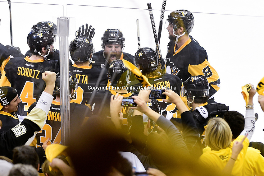Wednesday, June 1, 2016: Pittsburgh Penguins right wing Phil Kessel (81) celebrates with teammates at game 2 of the NHL Stanley Cup Finals  between the San Jose Sharks and the Pittsburgh Penguins held at the CONSOL Energy Center in Pittsburgh Pennsylvania. The Penguins beat the Sharks in overtime 2-1 and lead the best of 7 series 2-0. Eric Canha/CSM