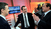 Il leader del Popolo della Liberta' Silvio Berlusconi, a destra, parla col conduttore televisivo Antonello Piroso, sinistra, ed il giornalista Antonio Polito, poco prima della trasmissione Omnibus negli studi di La7 a Roma, 9 aprile 2008..Leader of the People of Freedom Silvio Berlusconi, right, talks to TV show host Antonello Piroso, left, and journalist Antonio Polito prior to the talk show 'Omnibus', broadcasted by LA7 television in Rome, 9 april 2008. At right, show host Antonello Piroso..UPDATE IMAGES PRESS/Riccardo De Luca