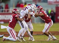 NWA Democrat-Gazette/BEN GOFF @NWABENGOFF<br /> Myles Mason (from left), Joe Foucha and Zach Williams, Arkansas defenders, tackle Austin Williams, Mississippi State wide receiver, in the third quarter Saturday, Nov. 2, 2019, at Reynolds Razorback Stadium in Fayetteville.
