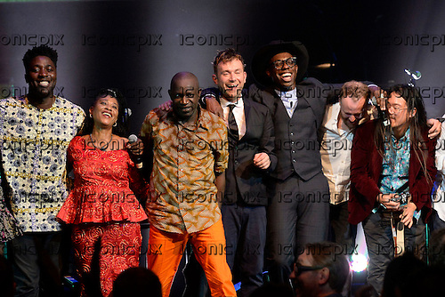 L-R: Kele (Bloc Party), one half of The Lijadu Sisters, Nigerian Percuassionist, Damon Albarn, Ghostpoet, Pat Manoney (LCD Soundsystem), Jonny Lam (guitar) - performing live Atomic Bomb: Who is William Onyeabor at the Barbican Hall in London UK - 01 Apr 2014.  Photo credit: George Chin/IconicPix