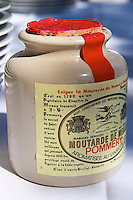 A ceramic French mustard pot with a red lid - Château Pey la Tour, previously Clos de la Tour or de Latour, Bordeaux, France