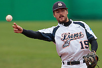 17 October 2010: Romain Martinez-Scott of Savigny throws the ball to first base during Rouen 10-5 win over Savigny, during game 2 of the French championship finals, in Savigny sur Orge, France.