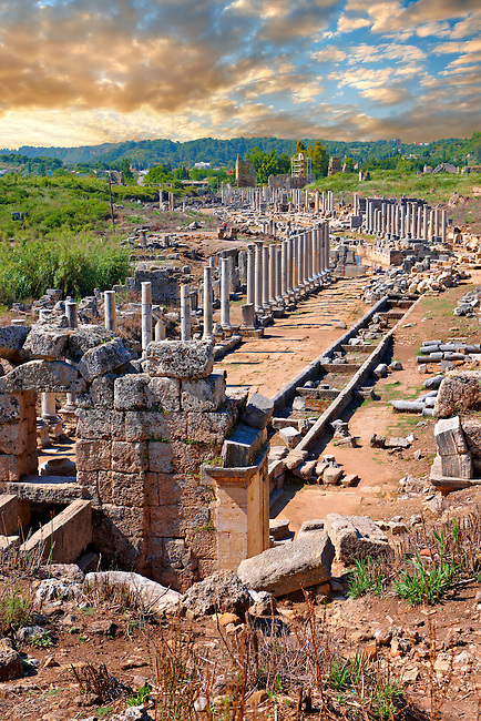 Ruins of the Roman Columned street which was lined with shops & stores. Down the centre of the street runs a canal which was full of running water from the Fountain of the Acropolis in the foreground. Perge (Perga) archaeological site, Turkey