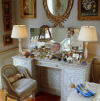 The dressing table in the Duchess of Windsor's bedroom is a confection of pale blue silk moire