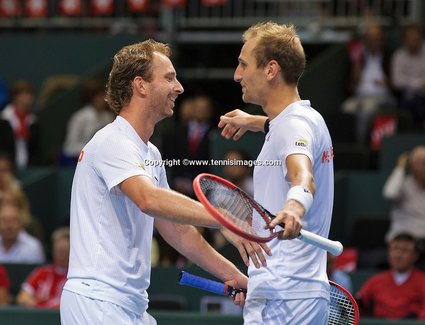 Switserland, Genève, September 19, 2015, Tennis,   Davis Cup, Switserland-Netherlands, Doubles: Matwe Middelkoop and Thiemo de Bakker  (R) fall into eachothers arms after defeating FedererChiudinerlli <br /> Photo: Tennisimages/Henk Koster