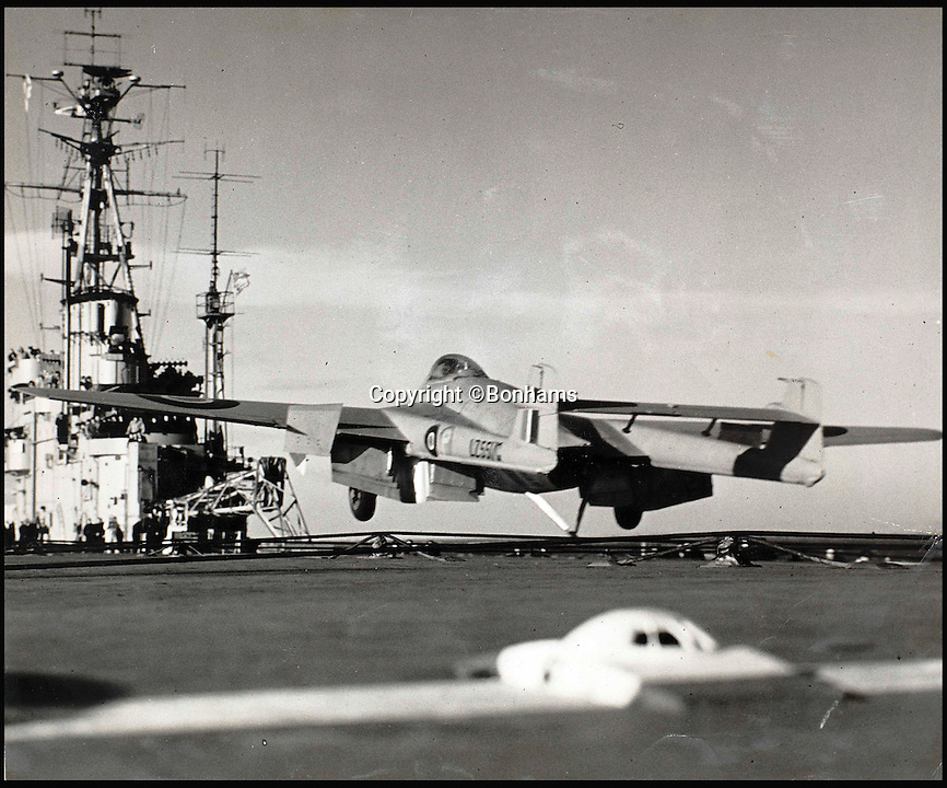 BNPS.co.uk (01202 558833)<br /> Pic: Bonhams/BNPS<br /> <br /> Eric Brown flying a Sea Vampire in a record breaking flight in December 1945 on an aircraft carrier in the North Sea. It was the first jet-propelled aircraft to land on a carrier.<br /> <br /> The historic medals and logbooks of legendary test pilot Eric 'Winkle' Brown have been saved for the nation and will be displayed in a British museum.<br /> <br /> A deal has been secured for the hero's prestigious decorations and all his flying journals after they failed to sell at auction earlier this week.<br /> <br /> They had been expected to sell for &pound;200,000, possibly to an overseas buyer, but bidding only reached &pound;140,000, falling short of the reserve price.<br /> <br /> Now it has emerged that the National Museum of the Royal Navy has negotiated a deal with Captain Brown's family to buy his stunning archive. amassed during his 30 year career.