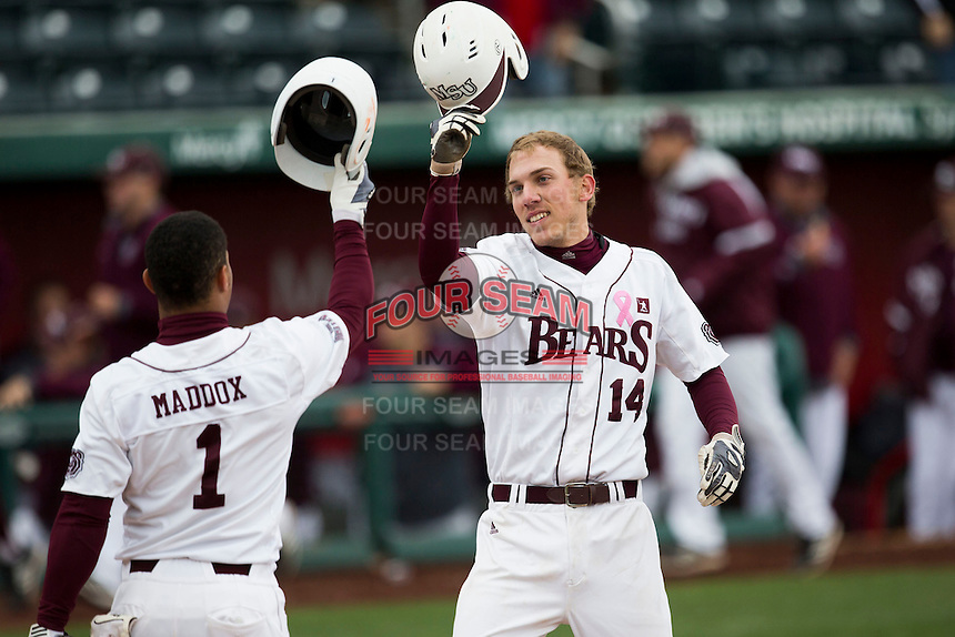 Eric Cheray #14 of the Missouri State Bears hits helmets with Keenen Maddox #1 of the Missouri State Bears after hitting a home run during a game against the Wichita State Shockers at Hammons Field on May 4, 2013 in Springfield, Missouri. (David Welker/Four Seam Images)