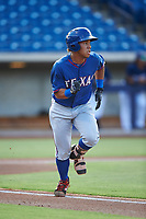 AZL Rangers Heriberto Hernandez (4) runs to first base during an Arizona League game against the AZL Brewers Blue on July 11, 2019 at American Family Fields of Phoenix in Phoenix, Arizona. The AZL Rangers defeated the AZL Brewers Blue 5-2. (Zachary Lucy/Four Seam Images)