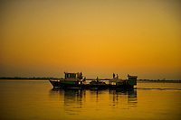 The Brahmaputra river that flows into India is wide enough to hold a few island towns. Ferries ply across the river to reach these towns.