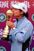 HAIKOU, CHINA - OCTOBER 31:  Lorena Ochoa of Mexico poses with the Mission Hills Start Trophy after winning the tournament at Mission Hills Resort on October 31, 2010 in Haikou, China.  The Mission Hills Star Trophy is Asia's leading leisure liflestyle event and features Hollywood celebrities and international golf stars.  Photo by Victor Fraile / studioEAST