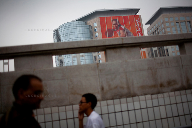 Massive Olympics signs cover the building facade of a new shopping mall in downtown Beijing, China on Sunday, August 10, 2008.  Kevin German