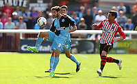 Joe Jacobson of Wycombe Wanderers controls the ball from Lee Holmes of Exeter City during the Sky Bet League 2 match between Exeter City and Wycombe Wanderers at St James' Park, Exeter, England on 26 September 2015. Photo by Pinnacle Photo Agency.