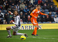 Pictured: Danny Graham of Swansea (R) and Jonas Olsson of West Bromwich (L). Saturday, 04 February 2012<br />