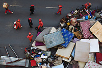Members of the the Red Ants make a pile from resident's possessions at Fatti's Mansions in Jeppe Street during an operation by 600 Red Ants to clear the 10-story block of its illegal occupants. The Red Ants are a controversial private security company often hired to clear squatters from land and so-called 'hijacked' properties.