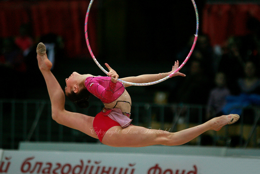 "Elizabeth Paisieva of Bulgaria split leaps for hoop re-catch at 2008 World Cup Kiev, ""Deriugina Cup"" in Kiev, Ukraine on March 22, 2008."
