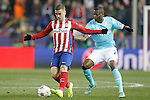 Atletico de Madrid's Antoine Griezmann (l) and PSV Eindhoven's Nicolas Isimat-Mirin during UEFA Champions League match. March 15,2016. (ALTERPHOTOS/Acero)
