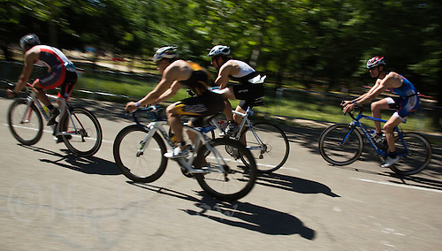 01 JUN 2013 - MADRID, ESP - Competitors make their way around the Casa de Campo cycle course in Madrid, Spain during their WTP Agemaster race (PHOTO (C) 2013 NIGEL FARROW)