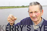 MEDAL: Ballyduff man John Wynne with the mysterious World War I medal found near the Cashen River.