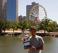 Roger Federer with the Australian Open trophy on the bank of the Yarra River..International Tennis - Australian Open Tennis - Monday 1 Feb 2010 - Melbourne Park - Melbourne - Australia ..© Frey - AMN Images, 1st Floor, Barry House, 20-22 Worple Road, London, SW19 4DH.Tel - +44 20 8947 0100.mfrey@advantagemedianet.com
