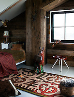 Luc's room has been designed to resemble a log cabin, with walls clad in rough wood