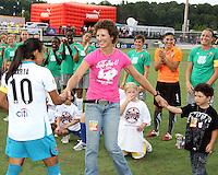 Michelle Akers greets Marta #10 of Marta's XI during the WPS All-Star game at KSU Stadium in Kennesaw, Georgia on June 30 2010. Marta XI won 5-2.