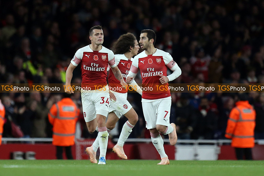 Henrikh Mkhitaryan of Arsenal is congratulated after scoring the first Arsenal goal during Arsenal vs Wolverhampton Wanderers, Premier League Football at the Emirates Stadium on 11th November 2018