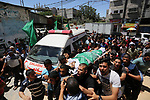 Mourners carry the body of 24-year-old Palestinian Mohammed al-Hamayda, who was killed by Israeli troops during clashes in tents protest where Palestinian demand the right to return to their homeland at the Israel-Gaza border, during his funeral in Rafah in the Southern Gaza Strip on June 30, 2018. Photo by Ashraf Amra