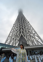 "May 22, 2012, Tokyo, Japan - The Tokyo Skytree, the worlds tallest self-standing terrestrial broadcast tower at 634 meters, opens to the public in downtown Tokyo on Tuesday, May 22, 2012...Despite the foul weather, some 8,000 visitors turned out on the first day to see the limited but 360-degree views of the nations capital from two observation decks. On the opening day alone, the operator expected about 200,000 visitors to Tokyo Skytree Town commercial complex, which consists of the tower, a 312-tenant shopping and restaurant zone called ""Tokyo Solamachi,"" an office building zone, an aquarium and a planetarium. (Photo by Natsuki Sakai/AFLO) AYF -mis-."