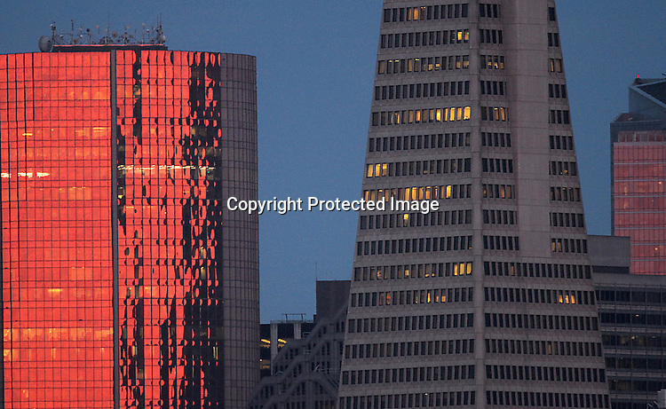 During suns reflection off a building in the financial district in San Francisco.