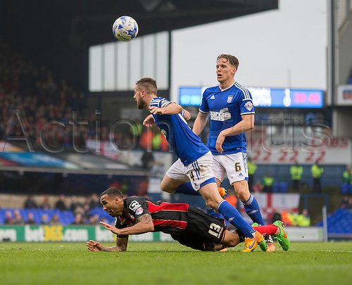 03.04.2015.  Ipswich, England. Skybet Championship. Ipswich Town versus AFC Bournemouth. Bournemouth's Callum Wilson appears to take a dive after the challenge from Ipswich Town's Luke Chambers.