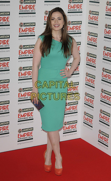 Hayley Atwell.The Jameson Empire Film Awards 2012, Grosvenor House Hotel, Park Lane, London, England..March 25th, 2012.full length green dress hand on hip red shoes clutch bag black.CAP/CAN.©Can Nguyen/Capital Pictures.