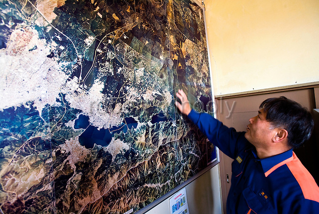 Masamichi Watanabe, chief of the Lake Kawaguchi fire department, indicates the area near his fire station called Aokigahara Jukai, which is better known as the Mt. Fuji suicide forest, in Yamanashi Prefecture, west of Tokyo, Japan on 04 Nov. 2009. ..
