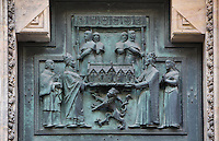 Bronze relief of the presentation of the church to the king, from one of the two doors of the central gate of the Main Portal or hlavni portal of St Vitus Cathedral, which is decorated with scenes of the building of the cathedral from 925-1929, St Vitus cathedral, a Gothic Roman catholic cathedral founded 1344, within Prague Castle, Prague, Czech Republic. The relief work was completed by O Spaniel according to the plans of V H Brunner. The cathedral's full name is the St Vitus, St Wenceslas and St Adalbert cathedral and is the largest church in the Czech Republic. The historic centre of Prague was declared a UNESCO World Heritage Site in 1992. Picture by Manuel Cohen