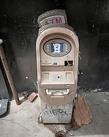 A dilapidated abandoned non-bank ATM machine in the Lower East Side neighborhood in New York on Thursday, July 14, 2016. By October all ATM owners will have to have their machines chip-enabled or face liability over fraud. The cost of upgrading or replacing the machines is so expensive that some operators of private ATM's are planning to shut down some of their machines. (© Richard B. Levine)