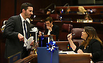 Nevada Assembly members, Wes Duncan, R-Las Vegas, and Teresa Benitez-Thompson, D-Reno, talk on the Assembly floor at the Legislative Building in Carson City, Nev., on Monday, April 22, 2013. .Photo by Cathleen Allison