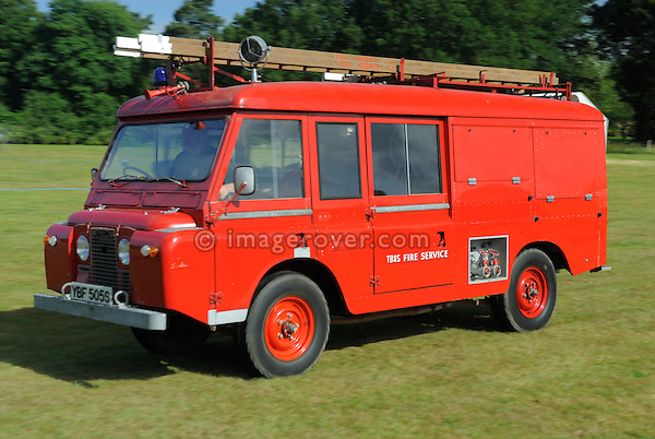 Historic 1960s Landrover Series 2a 109in Forward Control fire engine. Dunsfold Collection Open Day 2009, Dunsfold, England, UK. --- No releases available. Automotive trademarks are the proper, authorization may be needed for some uses. --- Information: Land Rover Series 2a 109in Forward Control fire engine belonging to the Dunsfold Collection; chassis number 23103850B, registration number YBF 505S, engine type 2.25 4-cyl petrol, gearbox type  4-speed manual. Vehicle History: A 109 Series 2a Forward Control with a difference. These odd vehicles were built by Charmichael, the famous fire appliance body builders and given the designation FT/6. The additon of another bulkhead and doors gave much needed crew and equipment space. The rear body, floor, fuel tank and seat box stay in their original places. The army and air force were amongst some of the many users. This vehicle was ex-army being released in 1975 and purchased by a copper wire factory where it was hardly used, having covered only 5900 miles until 1986 when it was retired..