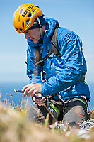 Dave Macleod getting his selection of cams ready for the Longhope Route, Hoy, Scotland