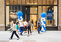 Customers enter and leave the brand new Marshalls store in Lower Manhattan in New York during it's grand opening on Thursday, May 18, 2017. The TJX Companies, parent of Marshalls and T. J. Maxx, after 10 quarters of sales growth, recently reported sales growth that missed analysts' expectations. Unfavorable weather was cited as the reason.  (© Richard B. Levine)