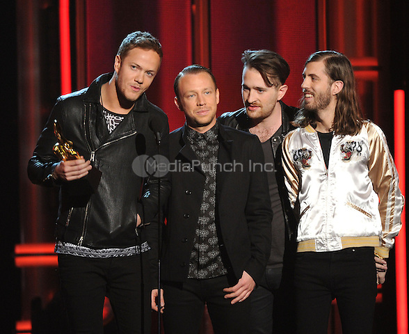 LAS VEGAS, NV - MAY 18: 5 Imagine Dragons  accept the Top Rock Artist award at the 2014 Billboard Music Awards at the MGM Grand Garden Arena on Sunday, May 18, 2014 in Las Vegas, Nevada. PgMicelotta/MediaPunch
