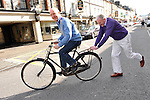 11-3-2013: REPRO FREE: On Yer Bike…. President of the Killarney Chamber of Tourism and Commerce Johnny Maguire, gets a friendly push from outgoing president Mike Buckley in Killarney on Monday after his election to the post. Mr. Maguire is famed  locally for his travel by bicycle.<br /> Picture by Don MacMonagle