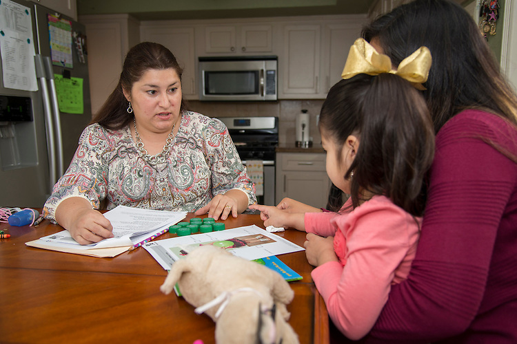 Houston ISD Home Instruction for Parents of Pre-K Youth (HIPPY) instructor Claudia Gutierrez, left, works with Rebeca Sosa, and her daughter, Vida, at their home, March 26, 2014.