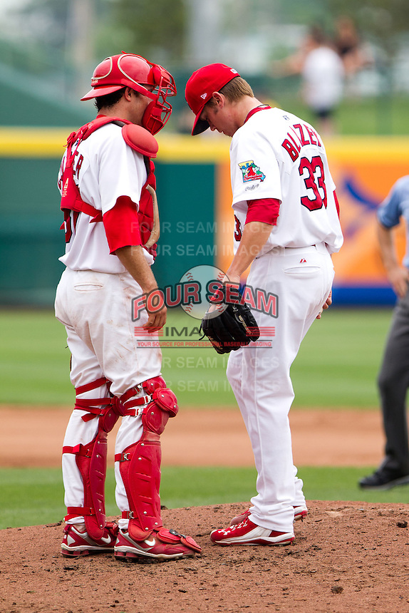 Charles Cutler (37) of the Springfield Cardinals talks with Michael Blazek (33) on the mound during a game against the Arkansas Travelers on May 10, 2011 at Hammons Field in Springfield, Missouri.  Photo By David Welker/Four Seam Images.