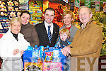 HAMPER: John Quinn, Manager Garveys SuperValu presented a large hamper to The Kerry Branch of the Irish Kidney Association on Saturday morning at their store in Tralee, for their forthcoming IKA Walk. L-r: Anne Loughnane, Deirdre Quinn (IKA), John Quinn (Manager Garveys SuperValu Tralee), Brona Tennyson, Eoghan O'Loughlin and Michael Quinn (IKA)..